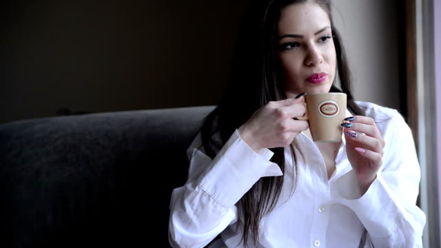 Woman drinking tea video
