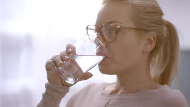 Woman drinking water video