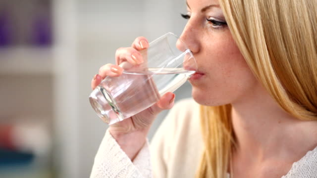 Woman drinking water,closeup. video