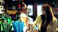 woman drinks in the pub - dolly video