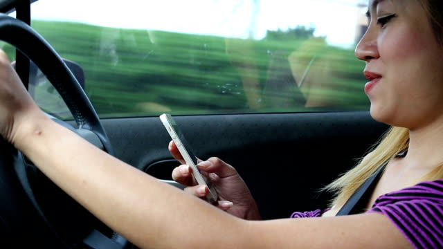 woman driver using a mobile phone video