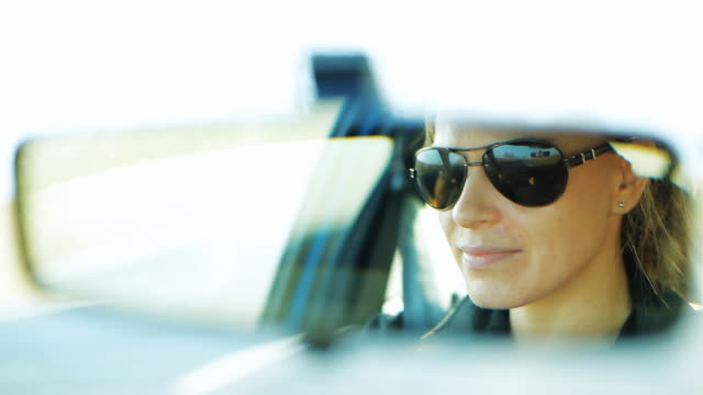 Woman driving a car in sunglasses video