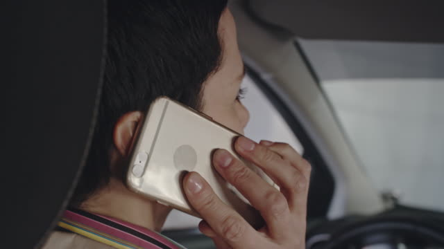 Woman Driving and Talking on Mobile video