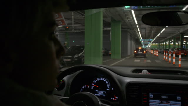 SLO MO Woman driving in a multi-storey car park video