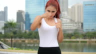 Woman during fitness and boxing video