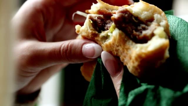 Woman eating a juicy burger video