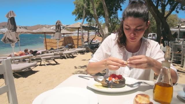 Woman eating a mediterranean dish. video
