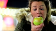 Woman eating apple. Fast motion video
