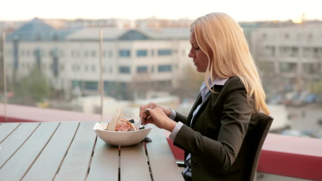 Woman eating caesar salad at restaurant video
