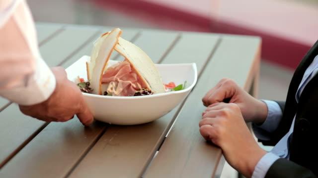 Woman eating caesar salad video