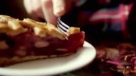 Woman eating cake and drinking tea in cafe in the city. Close-up of slice of pie video