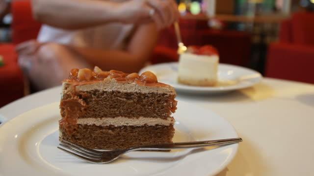 Woman eating cake video