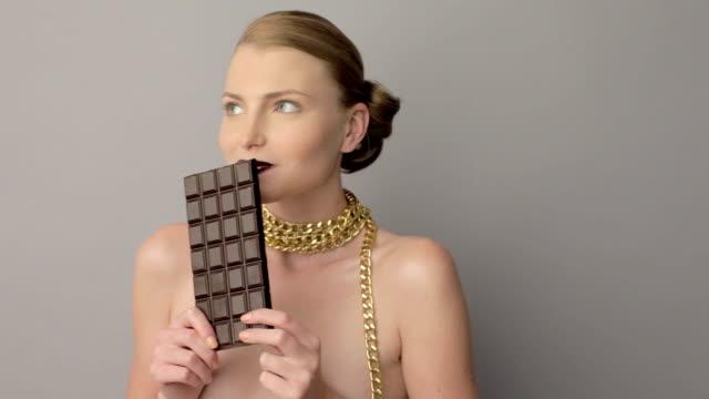 woman eating chocolate video
