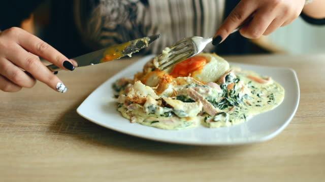 Woman eating English breakfast video