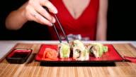 Woman Eating Green Sushi Rolls video