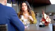 Woman eating in outdoor restaurant video
