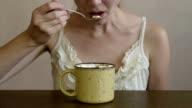 Woman eating marsh mallow video
