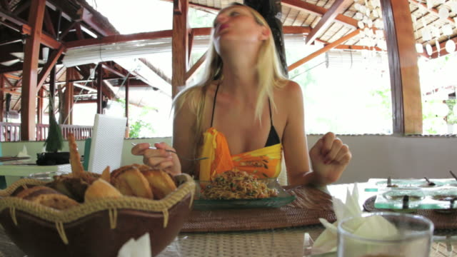 Woman eating pasta; sequence of 2 clips video