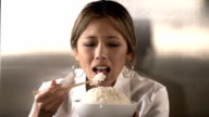 Woman eating rice - HD 1080p video