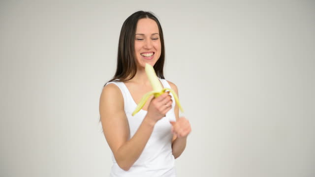 Woman eating ripe banana video