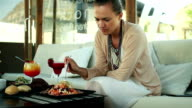 Woman eating salad in restaurant video