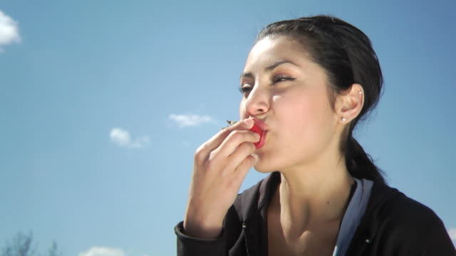 Woman eating strawberry video
