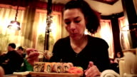 Woman eating sushi in Japanese restaurant video