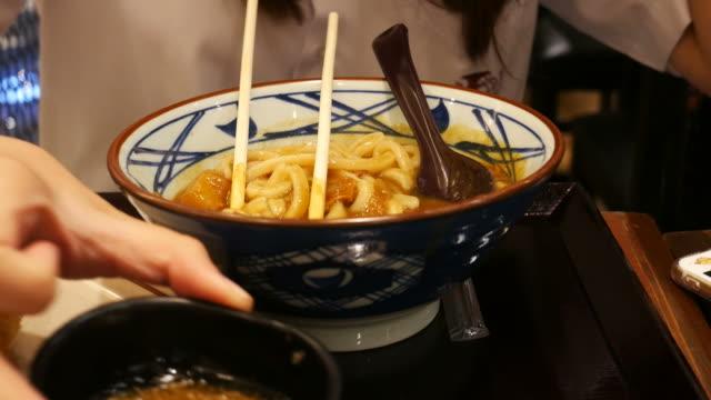 woman eats Korean food video