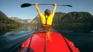 HD SLOW-MOTION: Woman enjoy kayaking in early morning video
