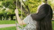 Woman enjoy swinging Slow Motion. video