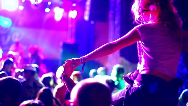 Woman enjoying a concert. video