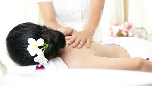 Woman enjoying a salt scrub massage for relax. video