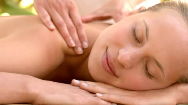 Woman enjoying a shoulder massage video