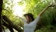 Woman enjoying beautiful day in nature,relaxing video