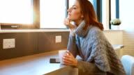 Woman enjoying coffee break video