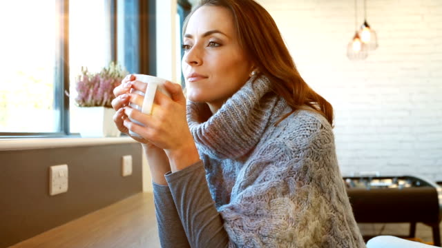 Woman enjoying coffee break video