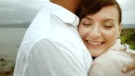 Woman enjoying her man's warm embrace video