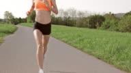SLO MO TS Woman enjoying her run through park video