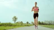SLO MO TS Woman enjoying her run video