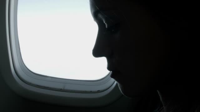 Woman enjoying the flight video