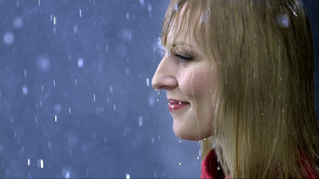 Woman Enjoying The Rain (Super Slow Motion) video