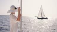 SLO MO Woman enjoying wind on the sea video