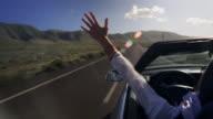 Woman enjoys car ride video