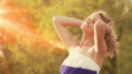 Woman enjoys freedom in the sun video