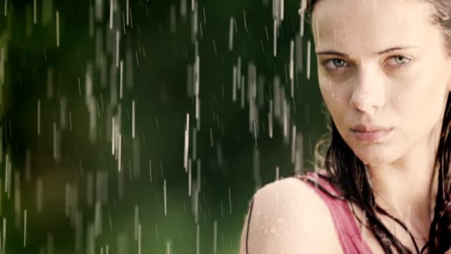 Woman enjoys summer rain video