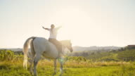 SLO MO Woman enjoys the freedom on a horse video