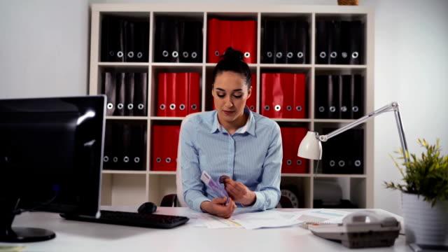 Woman entrepreneur counting euro money video