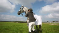Woman Equestrian Celebrating with Trophy in Hand video