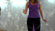 Woman exercises in gym video