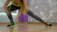 Woman exercises with drum sticks video
